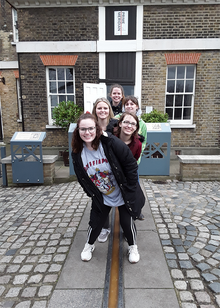 Penn State Wilkes-Barre honors students straddling the Prime Meridian in Greenwich, England