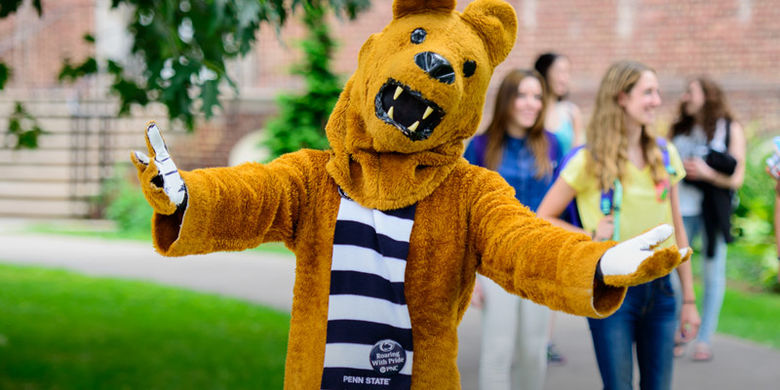 Nittany Lion mascot on campus with welcoming arms outspread