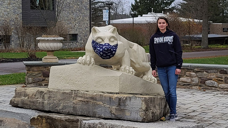 Ashley Tomeo at the Nittany Lion shrine on campus