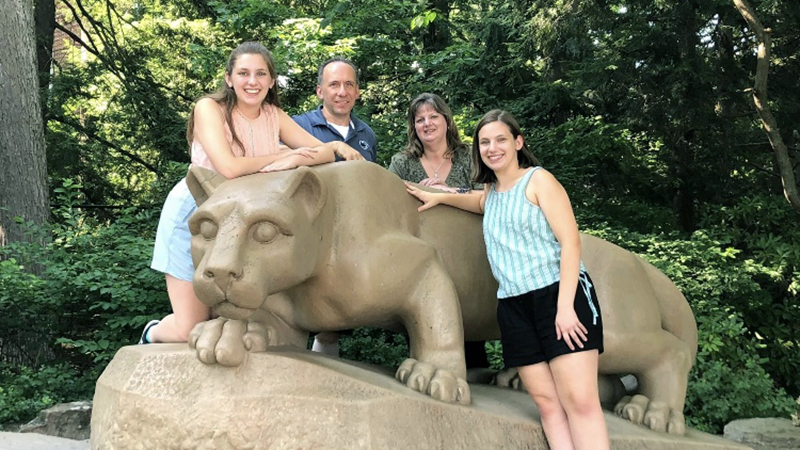 The Farber family (Hannah, Paul, Renée and Laura) at the Nittany Lion Shrine
