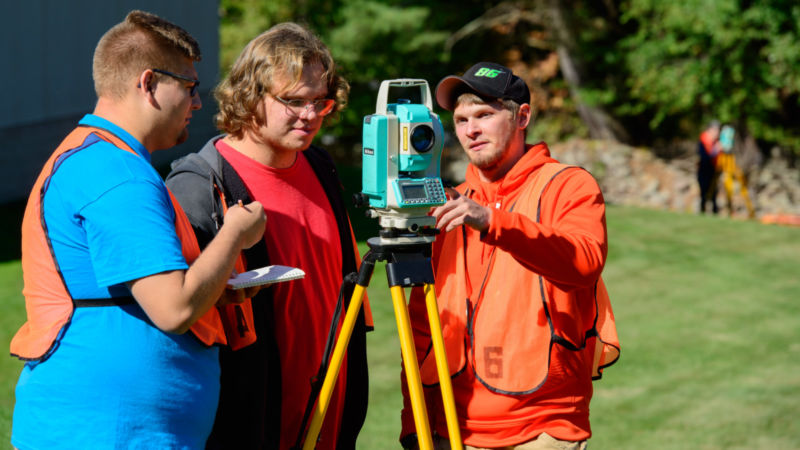 Kyle Neiswender with surveying classmates