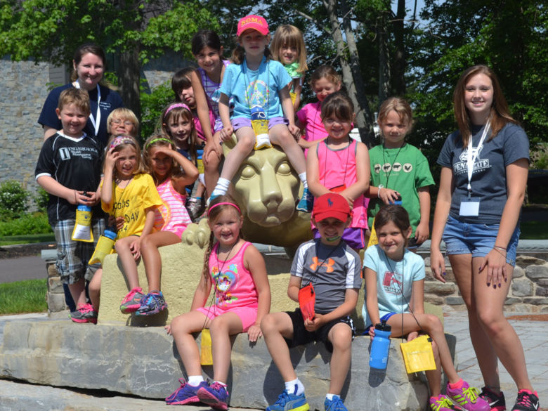 Group of children next to Nittany Lion statue