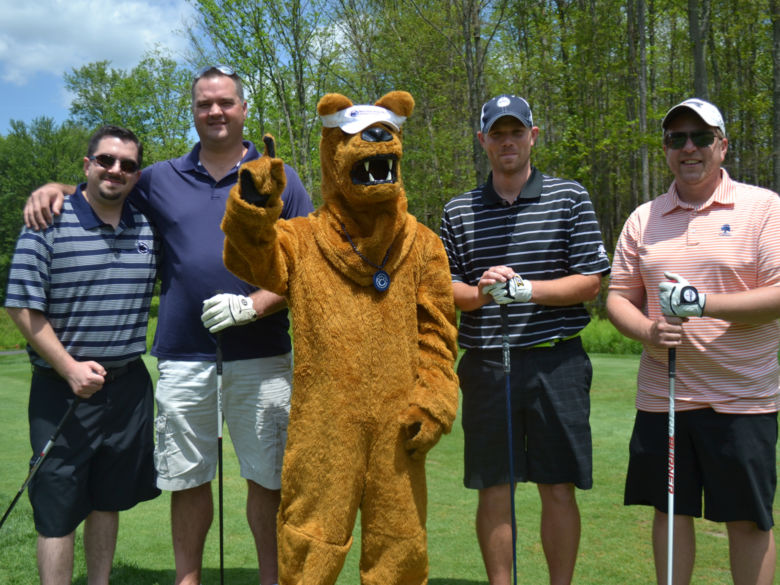 Group of golfers with Nittany Lion