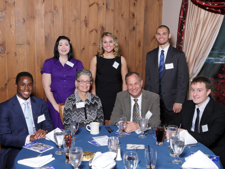 Faculty and students at a scholarship dinner