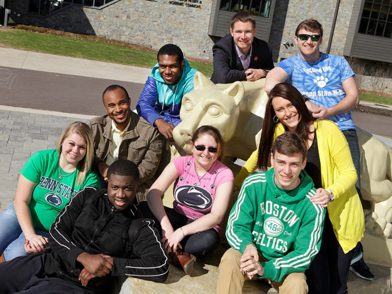 Group of students with the Nittany Lion statue