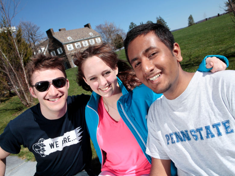 Three friends on campus having fun