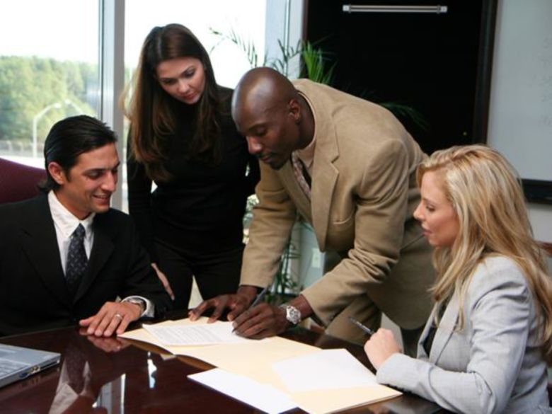 A group of business associates working around a table