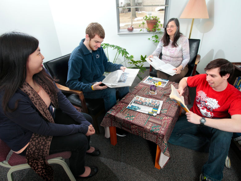 A small group of students meeting with a staff member in the Student Success Services office