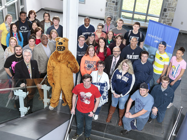 A large group of students, faculty, and staff with the Nittany Lion mascot