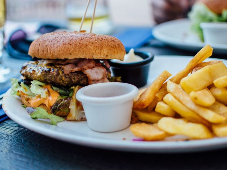 bacon hamburger and fries on a plate