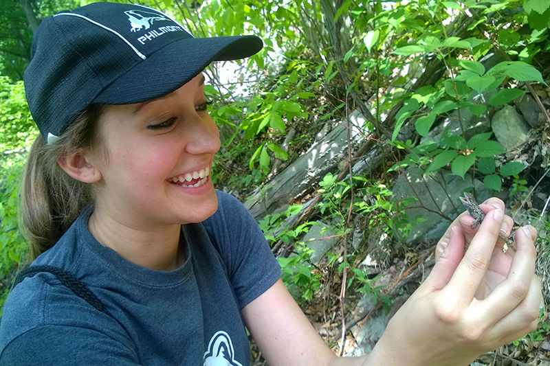 Bethany Dennis with her first lizard capture