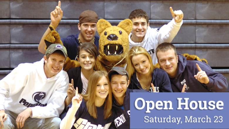 """Students gathered around the Nittany Lion mascot on bleachers in the gym. They are all holding up their index fingers in the """"We're #1"""" sign."""