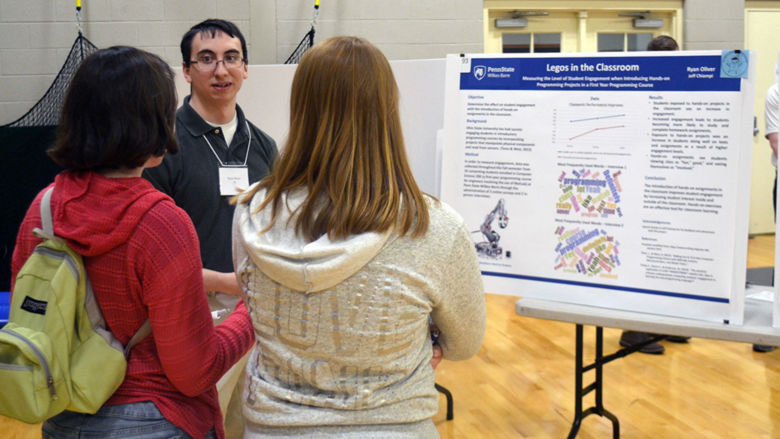 student presenting his poster at the Celebration of Scholarship event on campus
