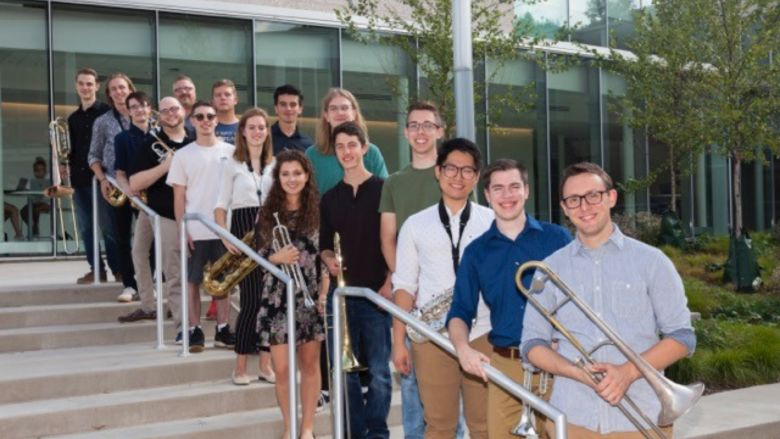 members of the Centre Dimensions jazz ensemble pose for a photo outside of a building