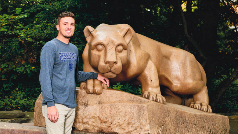 Sean-Paul Williamson at the Nittany Lion statue at University Park