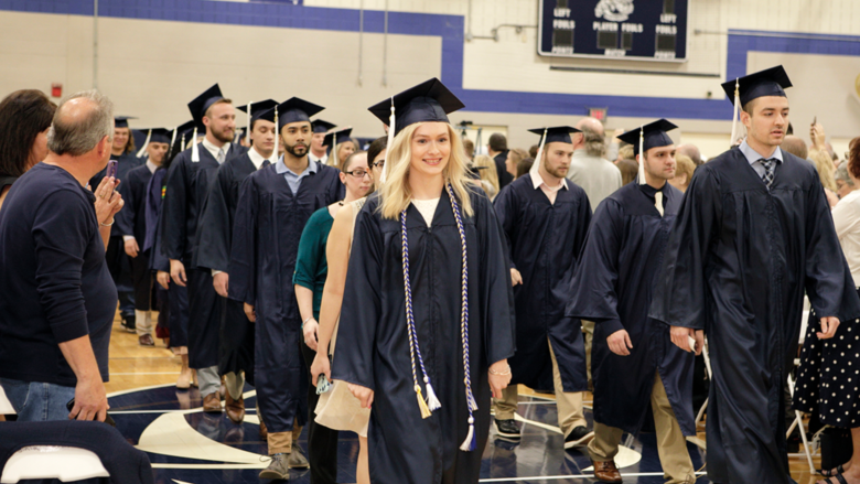 Penn State Wilkes-Barre students processing in their academic robes